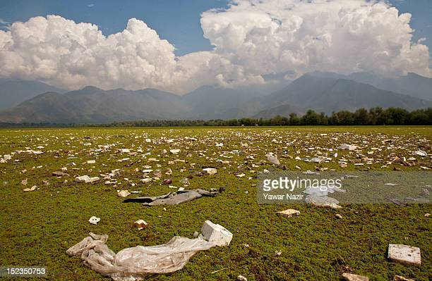 Nonbiodegradable waste floating in on the algae in the polluted lake on September 19 2012 in Wular 75 km north of Srinagar the summer capital of...