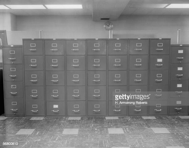 None metal filing cabinets along wall in office