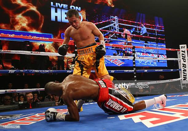 Nonito Donaire stands over Guillermo Rigondeaux which was ruled a slip during their WBO/WBA junior featherweight title unification bout at Radio City...
