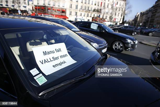 Nonlicensed private hire cab drivers stage a silent protest in Paris on February 3 2016 against the government's decision against their sector a week...