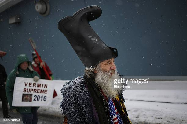 Nontraditional presidential candidate Vermin Supreme walks down the sidewalk outside a campaign stop for Senator Ted Cruz a Republican from Texas and...