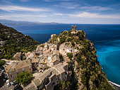 Aerial view of the beautiful village and castle of Nonza, in Cap Corse, Corsica, France