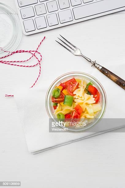 Noodle salat in glass at the workplace