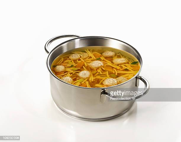 Noodles and dumplings in pan