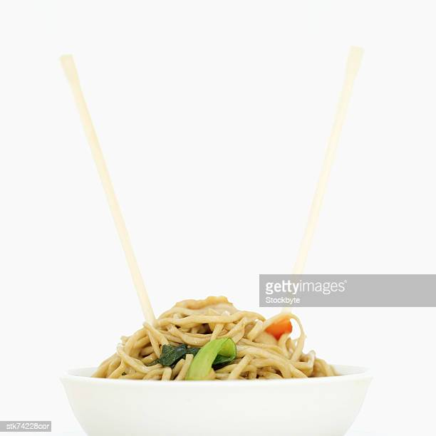 noodles in a bowl with chopsticks