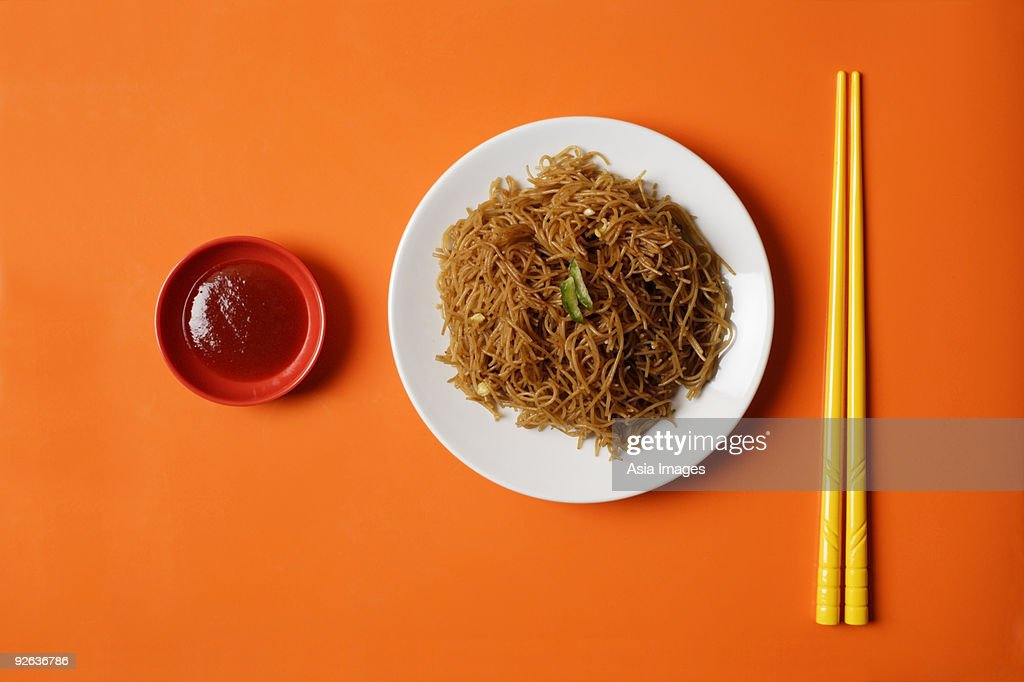 Noodles on plate with chopsticks. : Stock Photo
