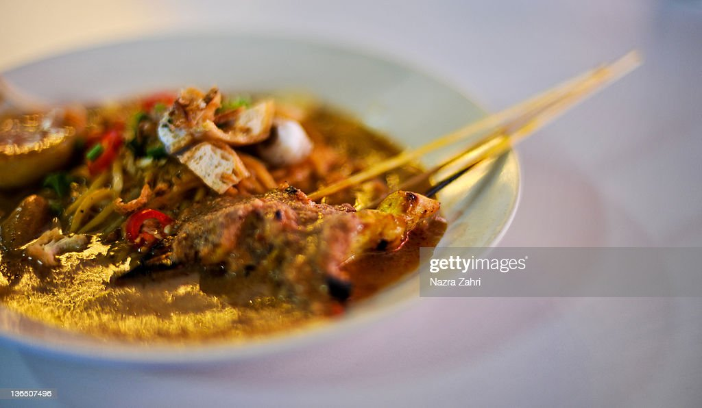 Noodles with grilled meat in dish