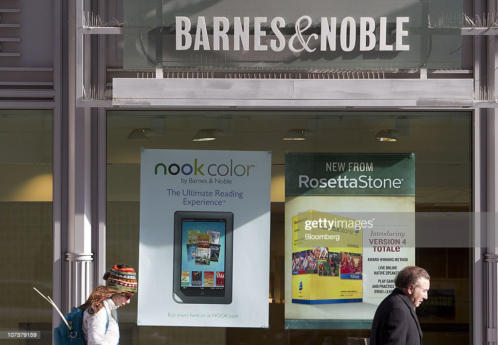 A Nook electronic book reader advertisement sits in the window of a Barnes Noble Inc bookstore in Washington DC US on Tuesday Dec 7 2010 Barnes Noble...