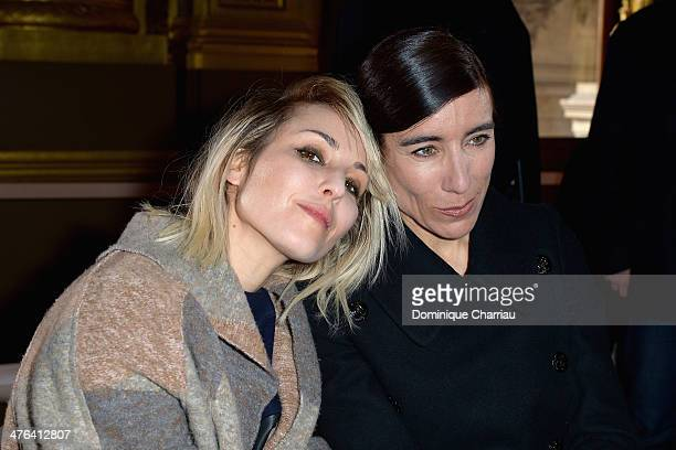Noomi Rapace and Bianca Li attend the Stella McCartney show as part of the Paris Fashion Week Womenswear Fall/Winter 20142015 on March 3 2014 in...