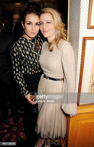Noomi Rapace and Gillian Anderson attend the Charles Finch and Chanel PreBAFTA cocktail party and dinner at Annabel's on February 8 2013 in London...