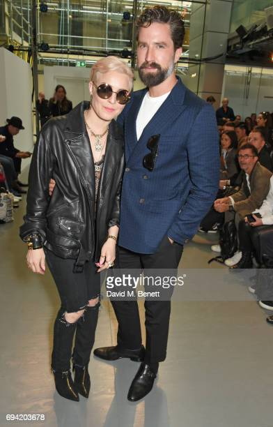 Noomi Rapace and Jack Guinness attend the Oliver Spencer SS18 Catwalk Show during London Fashion Week Men's June 2017 on June 9 2017 in London England