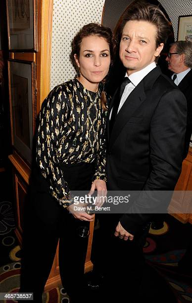 Noomi Rapace and Jeremy Renner attend the Charles Finch and Chanel PreBAFTA cocktail party and dinner at Annabel's on February 8 2013 in London...