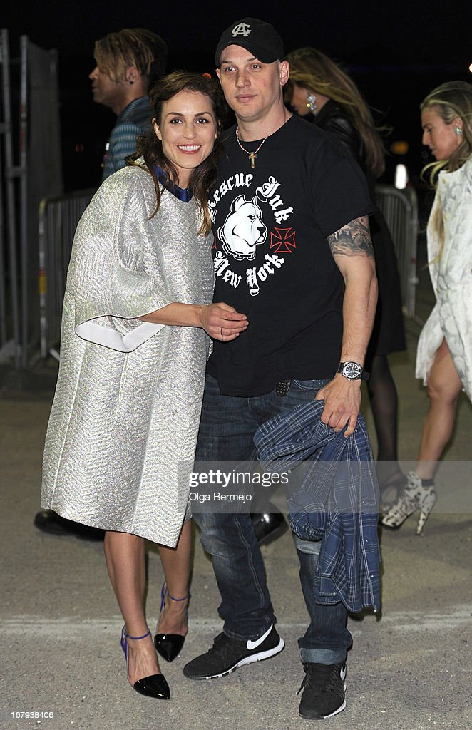 Noomi Rapace and Tom Hardy attend the annual fundraiser in aid of Gabrielle's Angel Foundation for Cancer Research at Battersea Power station on May 2, 2013 in London, England.