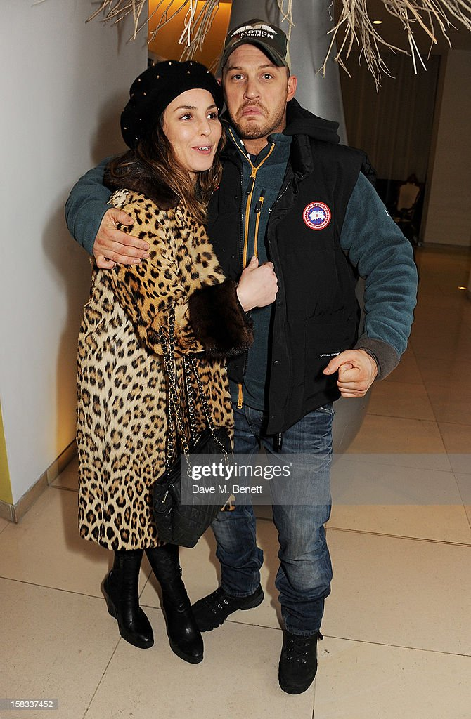 Noomi Rapace (L) and Tom Hardy attend the English National Ballet Christmas Party at St Martins Lane Hotel on December 13, 2012 in London, England.