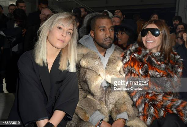 Noomi Rapace Kanye West and Carine Roitfeld attend the Givenchy Menswear Fall/Winter 20142015 Show as part of Paris Fashion Week on January 17 2014...
