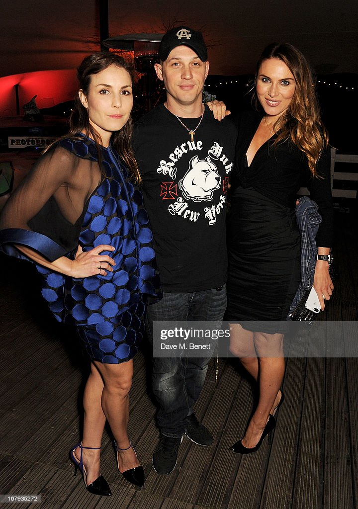 Noomi Rapace, Tom Hardy and Tonya Meli attend Gabrielle's Gala 2013 supported by Lorraine Schwartz at Battersea Power Station on May 2, 2013 in London, England.
