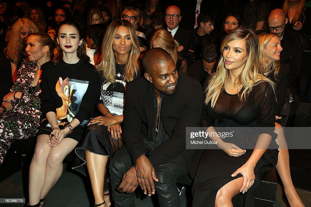 Noomie Rapace, <a gi-track='captionPersonalityLinkClicked' href=/galleries/search?phrase=Lily+Collins&family=editorial&specificpeople=3520243 ng-click='$event.stopPropagation()'>Lily Collins</a>, Kim Kardanshian, <a gi-track='captionPersonalityLinkClicked' href=/galleries/search?phrase=Kanye+West+-+Musician&family=editorial&specificpeople=201803 ng-click='$event.stopPropagation()'>Kanye West</a> and Ciara Princess Harris attend the Givenchy show as part of the Paris Fashion Week Womenswear Spring/Summer 2014 on September 29, 2013 in Paris, France.