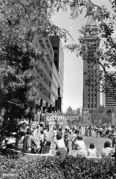 Noon Hour crowd at Skyline Park Music by sweetness Co Mobile Disco pony express danced Promo for Sat's ***** Credit Denver Post