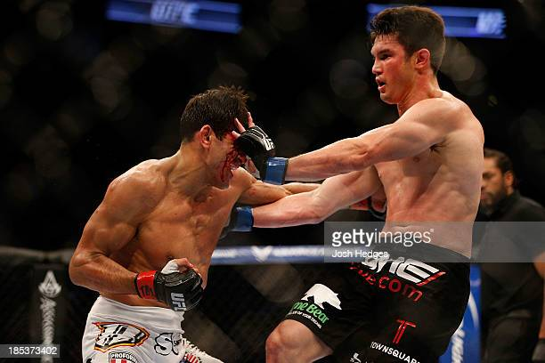 KJ Noons blocks a punch from George Sotiropoulos in their UFC lightweight bout at the Toyota Center on October 19 2013 in Houston Texas