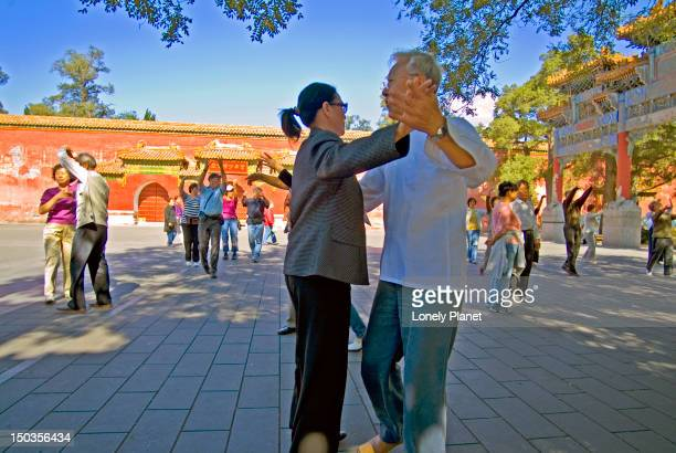 Noontime dancers waltz to old time Chinese tunes in Jing Shan Park.