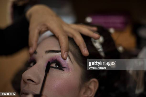 Noor age unknown prepares for her wedding later that day in a beauty salon in the Zaatari refugee camp in Jordan August 25 2014 While marriage under...