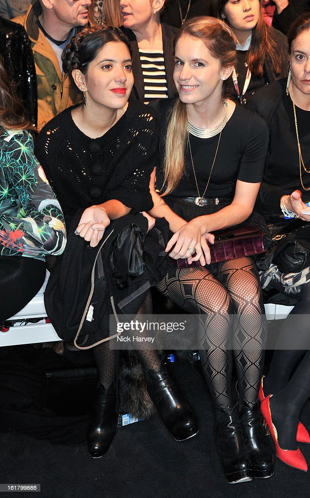 Noor Fares and Eugenie Niarchos attend and the Issa London show during London Fashion Week Fall/Winter 2013/14 at Somerset House on February 16, 2013 in London, England.