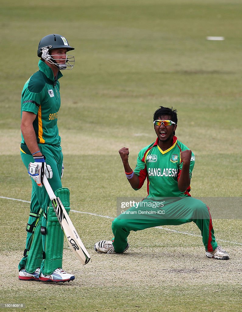 Noor Hossain of Bangladesh (R) celebrates the wicket of Quinton de Kock of South Africa as South African team mate Theunis de Bruyn looks dejected during the ICC U19 Cricket World Cup 2012 match between South Africa and Bangladesh at Allan Border Field on August 12, 2012 in Brisbane, Australia.