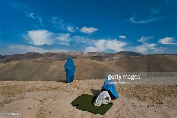 FAIZABAD AFGHANISTAN NOVEMBER 14 2009 Noor Nisa right a pregnant woman whose water had just broken and her mother Nazer Begam wait roadside after...