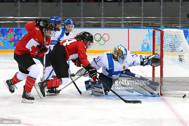 Noora Raty of Finland makes a save against Canada during the Women's Ice Hockey Preliminary Round Group A game on day three of the Sochi 2014 Winter...