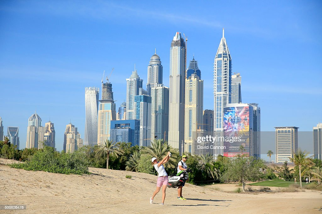 Noora Tamminen of Finland plays her second shot at the par 5 13th hole during the first round of the 2015 Omega Dubai Ladies Masters on the Majlis...