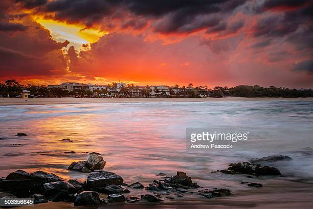 Noosa Heads beach and a storm at sunset