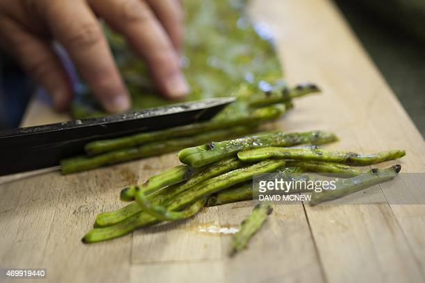 Nopales pear cactus leaves are prepared for cooking at the annual traditional agave roast at the Malki Museum on the Morongo Indian Reservation near...