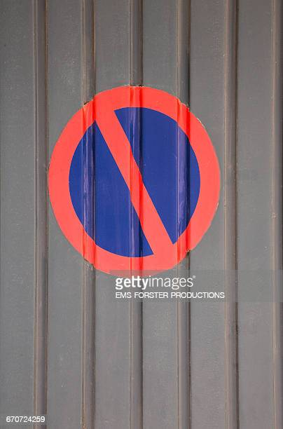 no-parking sign on a garage gate