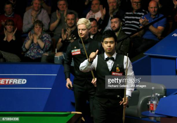 Noppon Saengkham acknowledges the crowd as he leaves the table after defeat to Neil Robertson on day six of the Betfred Snooker World Championships...