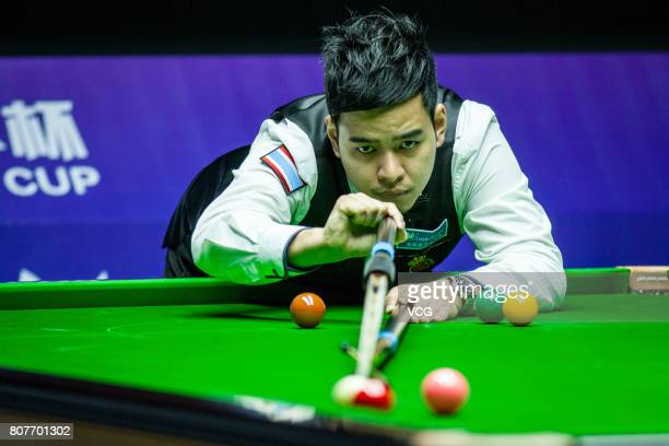 Noppon Saengkham of Thailand plays a shot against John Higgins of Scotland and Anthony McGill of Scotland on day one of 2017 Snooker World Cup at...