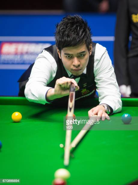 Noppon Saengkham of Thailand plays a shot during his first round match against Neil Robertson of Australia on day six of Betfred World Championship...
