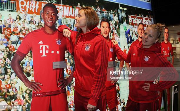 Nora Holstad and Leonie Maier of FC Bayern Muenchen pose next to lifesize images of FC Bayern players David Alaba and Juan Bernat before the official...