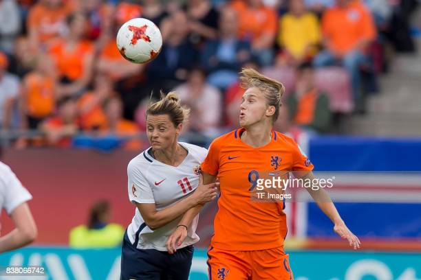 Nora Holstad Berge of Norway and Vivianne Miedema of the Netherlands battle for the ball during their Group A match between Netherlands and Norway...