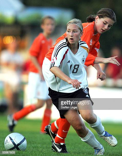 Nora Kirstein of Germany competes with Marloes Hulshof of the Netherlands during the womens under 15 friendly match between Germany and the...