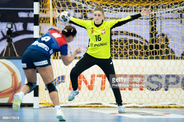 Nora Mork of Norway and Adrianna Placzek of Poland in action during IHF Women's Handball World Championship group match between Poland and Norway on...