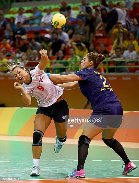 Nora Mork of Norway takes a shot as Oana Manea of Romania defends on Day 9 of the Rio 2016 Olympic Games at the Future Arena on August 14 2016 in Rio...