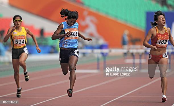 Noraseela Mohd Khalid of Malaysia Jauna Murmu of India and Yang Qi of China compete in their women's 400m hurdles heat in the athletics competition...
