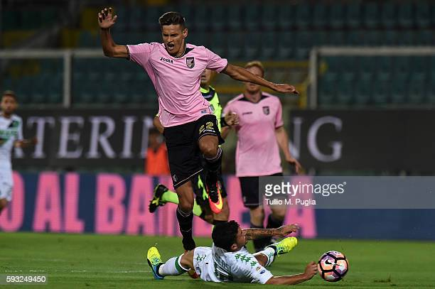 Norbert Balogh of Palermo jumps as Stefano Sensi of Sassuolo tackles during the Serie A match between US Citta di Palermo and US Sassuolo at Stadio...