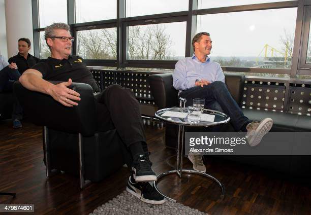 Norbert Dickel and Borussia Dortmund's sports director Michael Zorc are seen watching the UEFA Champions League draw on television on March 21 2014...