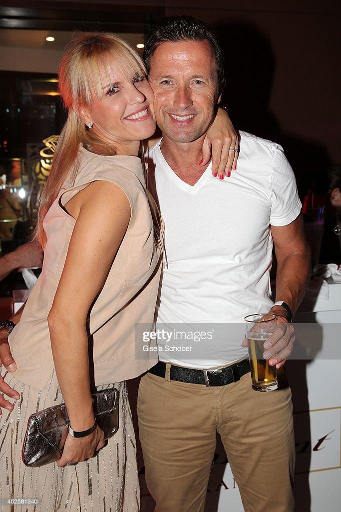 Norbert Dobeleit and his wife Tamara Sedmak Dobeleit attend the Eclat Dore summer party at Hotel Vier Jahreszeiten Kempinski on July 23, 2014 in Munich, Germany.