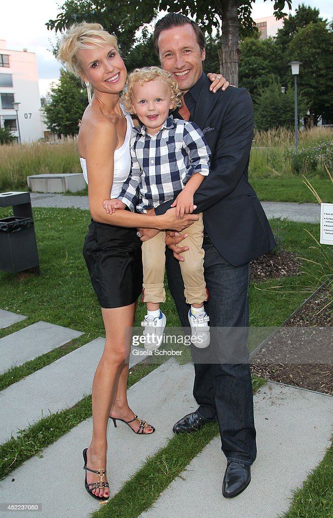 Norbert Dobeleit with his wife Tamara ad his son Julius attend the Norbert Dobeleit 50th birthday party at Stromberg Kutchiin on July 16, 2014 in Munich, Germany.