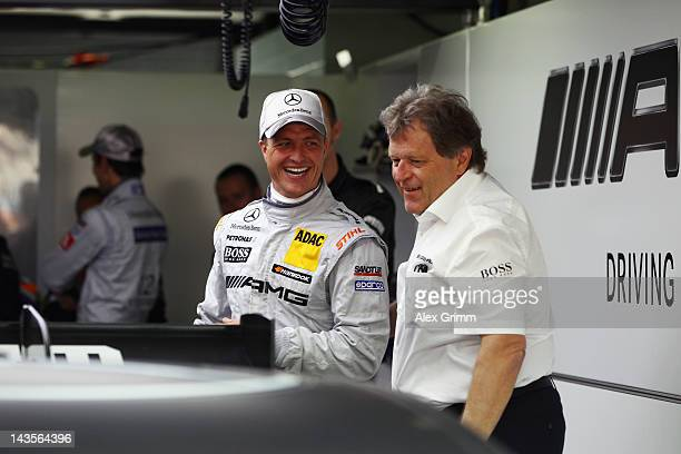 Norbert Haug director of Mercedes Motorsport chats with Mercedes AMG driver Ralf Schumacher prior to the first race of the DTM German Touring Car...
