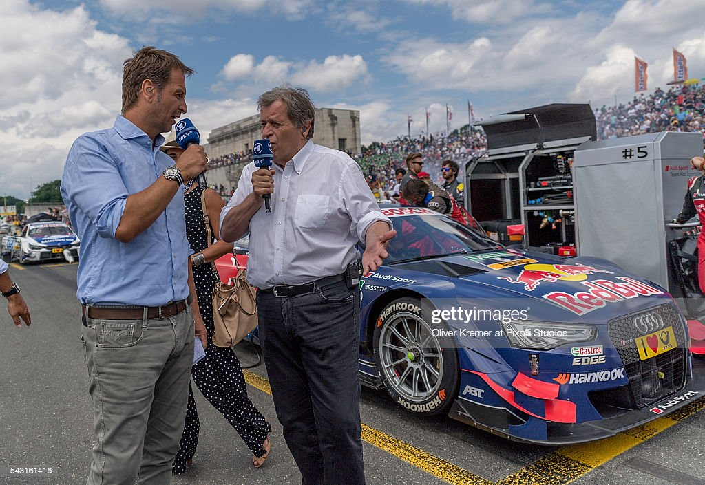 Norbert Haug of Mercedes getting interviewed prior to the German Touring Car Championship race at the Norisring during Day 3 of the 74. International ADAC Norisring Speedweekend on June 26, 2016 in Nuremberg, Germany.