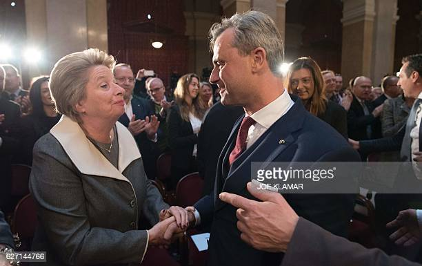 Norbert Hofer presidential candidate of Austria's rightwing Freedom Party FPOE is welcomed by his party colleague Ursula Stenzel as he arrives for...