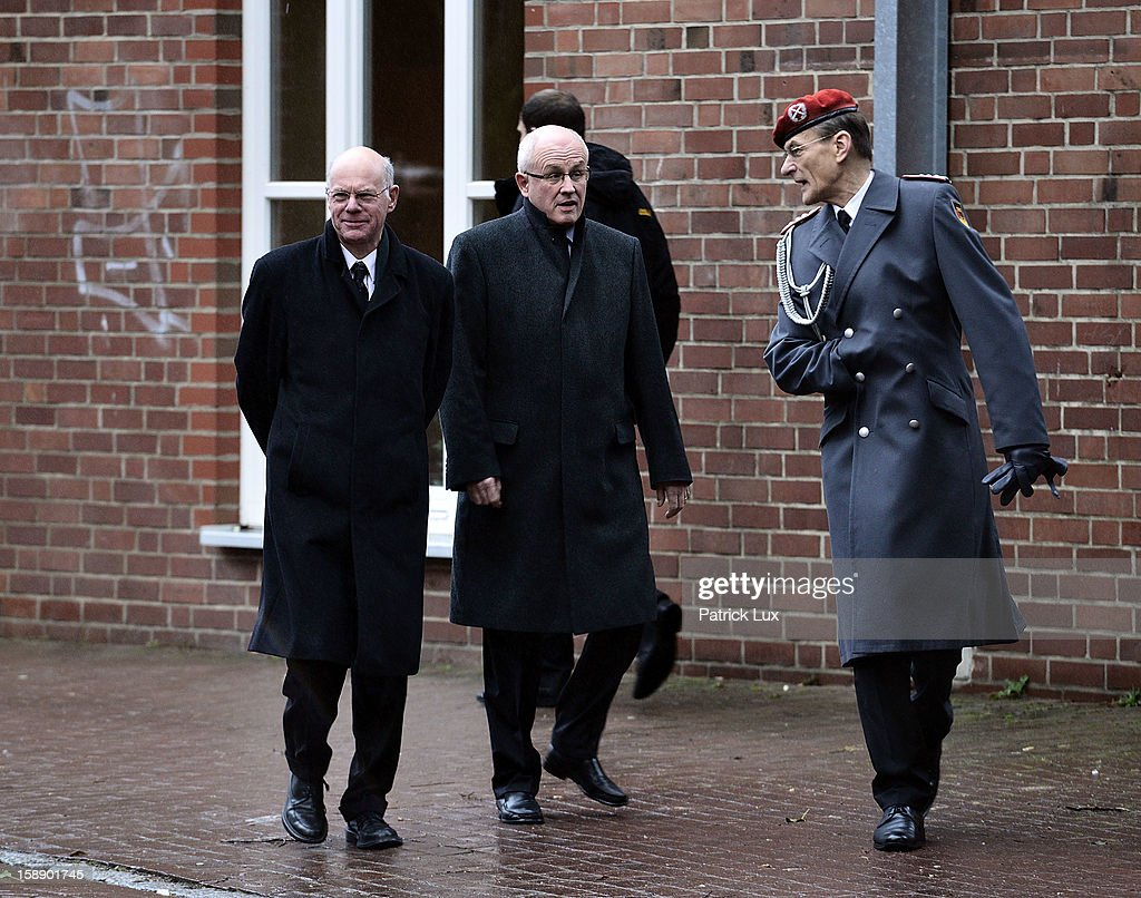 Norbert Lammert, President of German Bundestag (L), and Volker Kauder, head of the Bundestag faction of the German Christian Democrats (CDU/CSU) are greeted by Colonel Hubertus von Rohr, head of the protocol at the Defense ministy, as they arrive at a memorial service for former German Defence Minister Peter Struck on January 3, 2013 in Uelzen, Germany. Struck was a leading member of the German Social Democrats (SPD) and died in December following a heart attack.